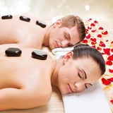 Attractive couple relaxing in spa salon. Stock Image