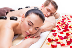 Attractive couple relaxing in spa salon. Royalty Free Stock Photo