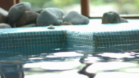 Attractive couple relaxing in swimming pool stock video footage