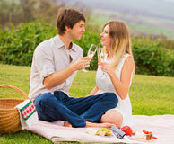 Attractive couple on romantic afternoon picnic Royalty Free Stock Images