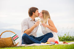 Attractive couple on romantic afternoon picnic kissing Royalty Free Stock Image