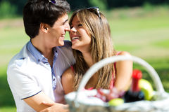 Attractive couple on romantic picnic in countryside. Royalty Free Stock Photos