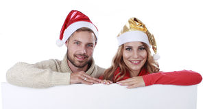 Attractive couple with Santa hat Stock Photos