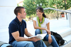 Attractive Couple at School Library. Attractive Man and Woman couple at School Library Royalty Free Stock Images