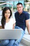 Attractive Couple at School Library. Attractive Man and Woman couple at School Library Royalty Free Stock Photos
