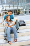 Attractive Couple at School Library Reading Royalty Free Stock Images