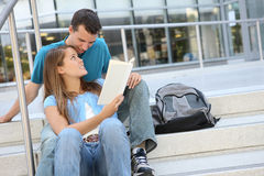 Attractive Couple at School Library Reading Royalty Free Stock Photos