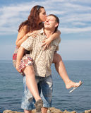 Attractive couple at the sea Royalty Free Stock Images