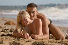 Attractive couple at the sea Royalty Free Stock Image