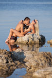Attractive couple at the sea Royalty Free Stock Photos