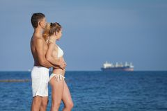 Attractive couple at the sea Stock Photo