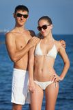 Attractive couple at the sea Stock Images