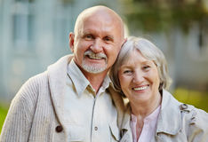Attractive couple. Seniors in casualwear lookng at camera outdoors Royalty Free Stock Images