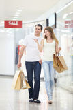 Attractive couple in shop Royalty Free Stock Photos