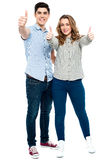 Attractive couple showing thumbs up Stock Photography