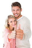 Attractive couple showing thumbs up to camera Royalty Free Stock Image