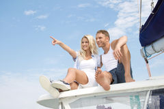 Attractive couple sitting on sailing boat - love. Stock Images