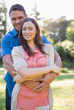 Attractive couple smiling at camera Stock Photography