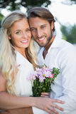 Attractive couple smiling at camera Royalty Free Stock Photos