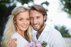 Attractive couple smiling at camera Royalty Free Stock Photography