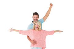 Attractive couple smiling and cheering Stock Photos