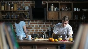 Attractive couple spending leisure in the kitchen stock footage