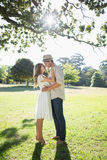 Attractive couple standing and embracing in park Royalty Free Stock Photo