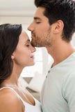 Attractive couple standing and hugging Royalty Free Stock Photos