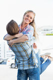 Attractive couple standing and hugging Stock Image