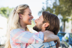 Attractive couple standing and hugging Stock Photos