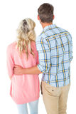 Attractive couple standing and looking Royalty Free Stock Photos