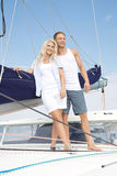 Attractive couple standing on sailing boat - sailing trip. Royalty Free Stock Image