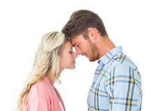 Attractive couple standing touching heads Stock Images