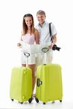 Attractive couple with suitcases Stock Images