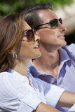 Attractive Couple In Sunshine Wearing Sunglasses royalty free stock image