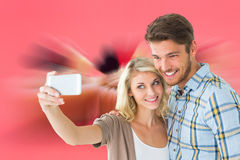 Attractive couple taking a selfie together Royalty Free Stock Photo