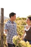 Attractive couple talking in the vineyard Stock Photography
