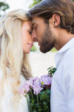 Attractive couple about to kiss each other Stock Photo