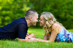 Attractive couple together on meadow Royalty Free Stock Photo