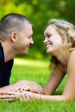 Attractive couple together on meadow Royalty Free Stock Images