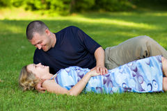Attractive couple together on meadow Royalty Free Stock Photos