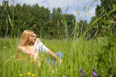 Attractive couple together on meadow Stock Photography