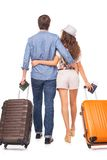 Attractive couple of tourist. Young couple is ready to travel, carrying luggage and passports Royalty Free Stock Photography
