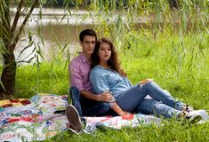 Attractive Couple Under Willow Tree Royalty Free Stock Image