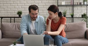 Attractive couple use laptop read fantastic news celebrate victory