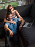 Attractive Couple Using A Laptop on couch Royalty Free Stock Image