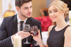 Attractive couple visiting luxury restaurant Royalty Free Stock Photos