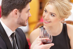 Attractive couple visiting luxury restaurant Stock Images