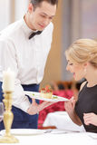 Attractive couple visiting luxury restaurant Stock Photo