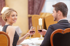 Attractive couple visiting luxury restaurant Stock Photography
